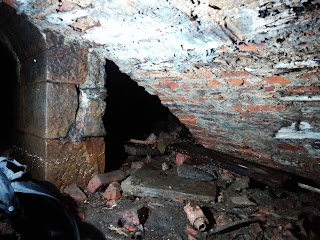 Inside the tunnel, the brickwork has wooden lining on the ceiling.derelictmanchester.com