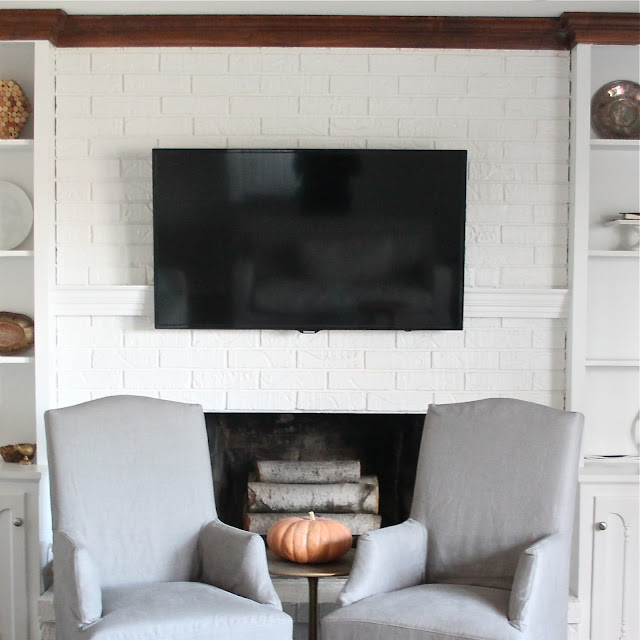 Easy & inexpensive DIY mantel to conceal tv and cable cords via www.julieblanner.com