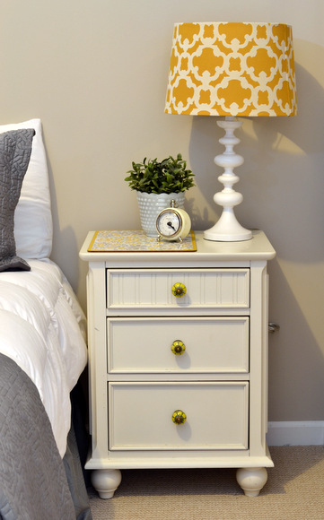 White nightstand with yellow target lamp