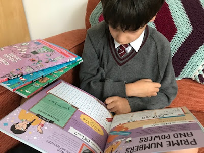 Child reading STEM Quest books