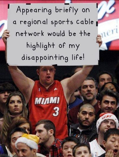 - Funny Miami fan sign. Appearing on a regional sports cable network.