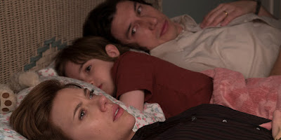"Nicole (Scarlett Johansson) and Charlie (Adam Driver) lay in bed with their son Henry (Azhy Robertson) in Noah Baumbach's latest film ""Marriage Story."""