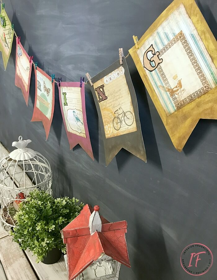 A DIY Vintage-Style Spring Banner easy dollar store craft perfect for a simple Spring paper garland to hang on a fireplace, mirror, or chalkboard.