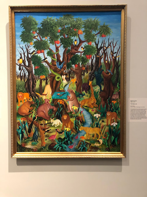 The Feast by Pierre Edugène reflects on the harshness of Haitian life through whimsical animals and the encroaching barren trees.