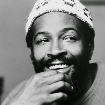 singer Marvin Gaye wearing beanie hat and smiling