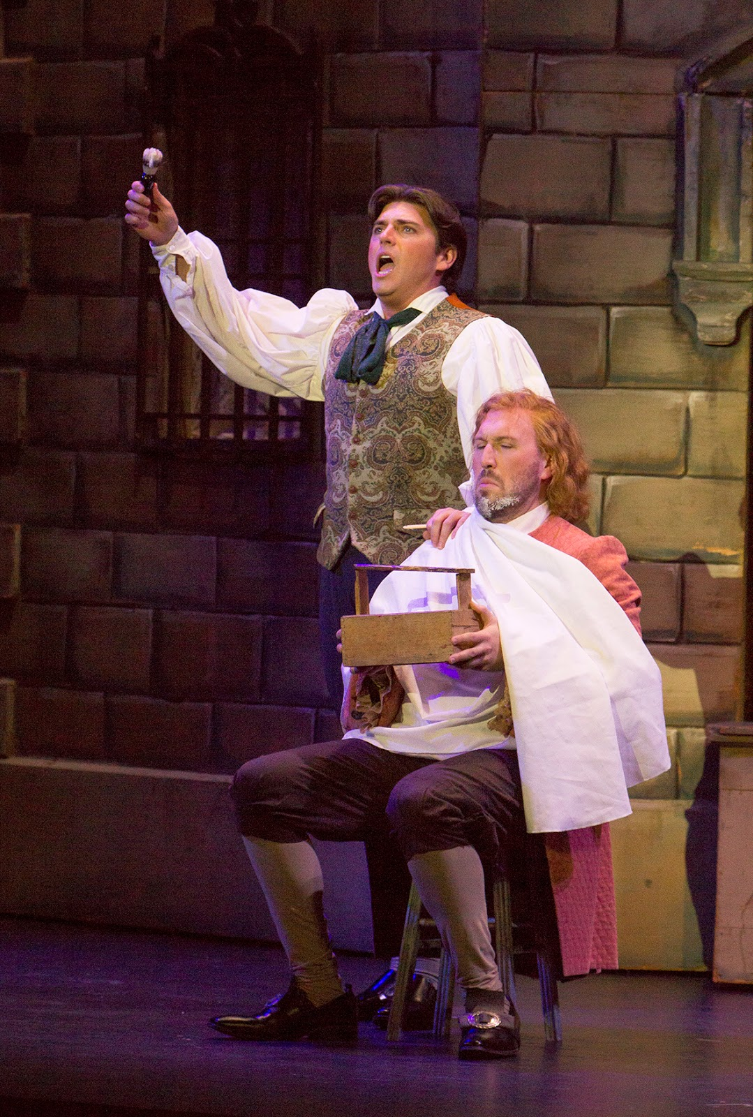 IN PERFORMANCE: baritones DAVID PERSHALL as Figaro (left) and RYAN HILL as Fiorello (right) in Greensboro Opera's production of Gioachino Rossini's IL BARBIERE DI SIVIGLIA, January 2018 [Photo by Star Path Images, © by Greensboro Opera]