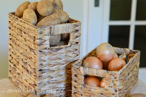 Storing potatoes and onions in baskets from Lowes | www.andersonandgrant.com