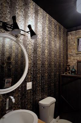 installed mid-century wall bathroom light fixture