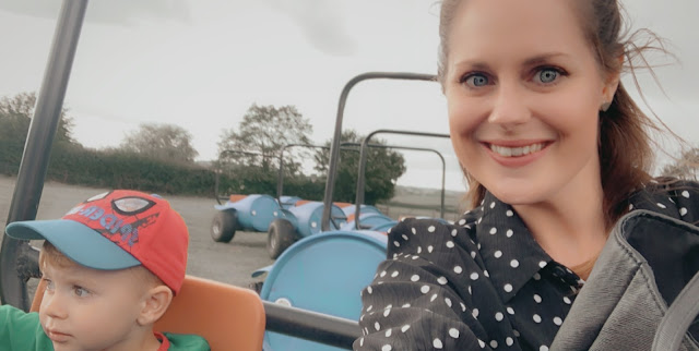 Mum and son on a barrel tractor ride