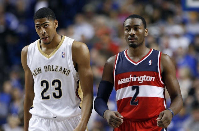 Anthony Davis (New Orleans Pelicans) et John Wall (Washington Wizards) lors d'un match NBA.
