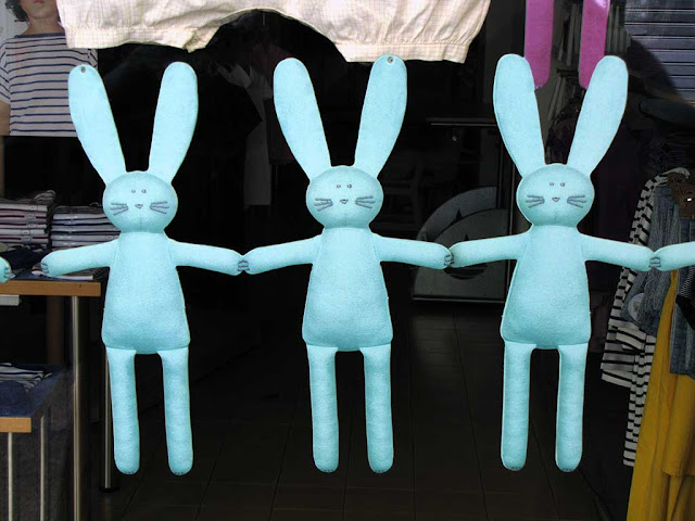 Three puppet rabbit in a shop window, Livorno