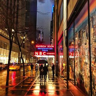 Couple walking on rainy street