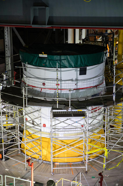 Inside the Vehicle Assembly Building at NASA's Kennedy Space Center in Florida, the Orion stage adapter is mated to the Space Launch System rocket...on October 9, 2021.