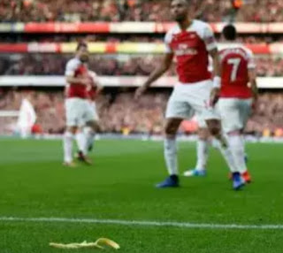 A Tottenham  fan has been arrested for throwing a banana skin onto the pitch at the Emirates Stadium as Aubameyang celebrated scoring a penalty in front of Tottenham fans.