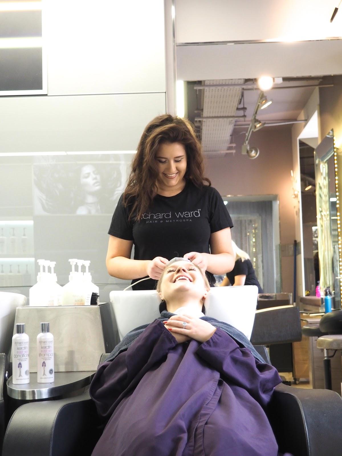 Hair Stylist washing girls hair at the Richard Ward Salon, Chelsea, London