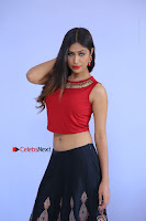 Telugu Actress Nishi Ganda Stills in Red Blouse and Black Skirt at Tik Tak Telugu Movie Audio Launch .COM 0038.JPG