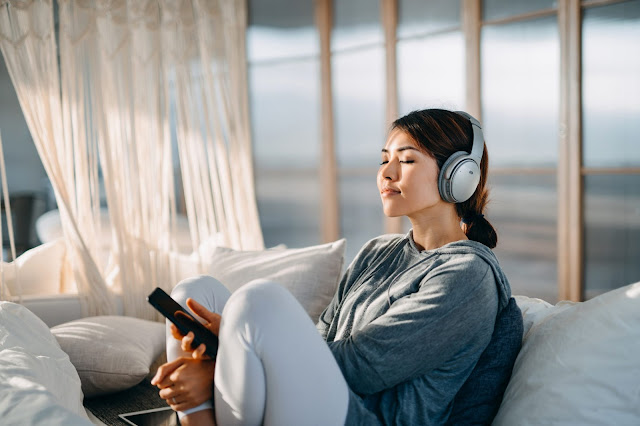 https://www.istockphoto.com/photo/relaxed-young-asian-woman-with-eyes-closed-sitting-on-her-bed-enjoying-music-over-gm1238998139-362515569