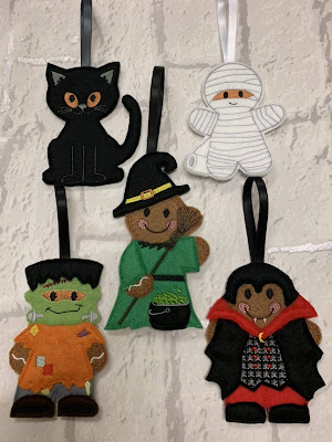 Halloween hanging decorations from felt and in the style of a cat, vampire, frankenstein and mummy