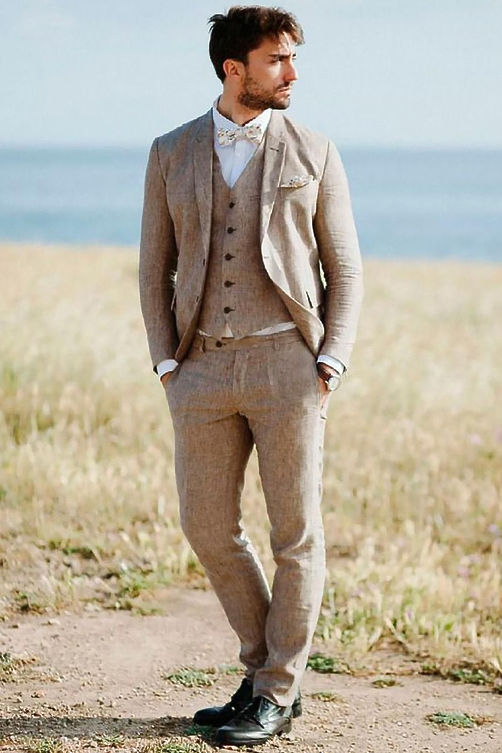 a man in a retro suit is posing in the field