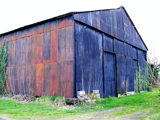 Corrugated iron shed.  Indre et Loire, France. Photographed by Susan Walter. Tour the Loire Valley with a classic car and a private guide.