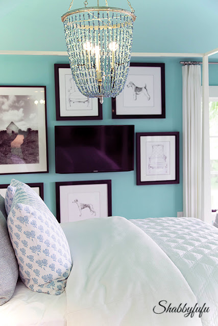More coastal colors in the master bedroom. This teal paint looks beautiful against white and black artwork.