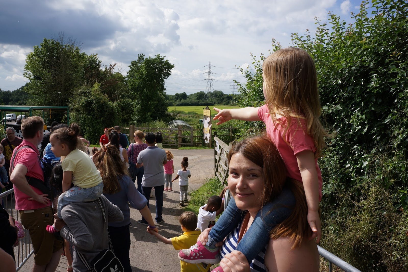 daughter on mums shoulders pointing