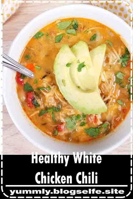 Healthy and Creamy White Chicken Chili with Greek Yogurt can be made in the crockpot, Instant Pot, or on the stove! If you're looking for an easy clean eating recipe, you've found one! This spicy chili recipe uses jalapenos and poblano peppers and is perfect for your holiday grazing table! 21 Day Fix Chili | 2B Mindset Chili | Portion Fix Chili | Healthy Chili Recipe #21dayfix #2bmindset #beachbody #chili
