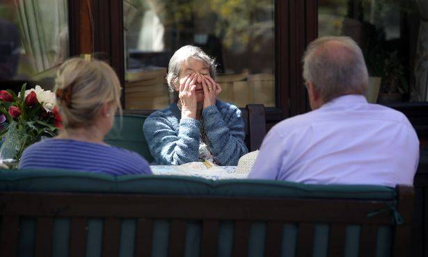 Grandma in tears as she sees her children for the first time since lockdown began (photos)
