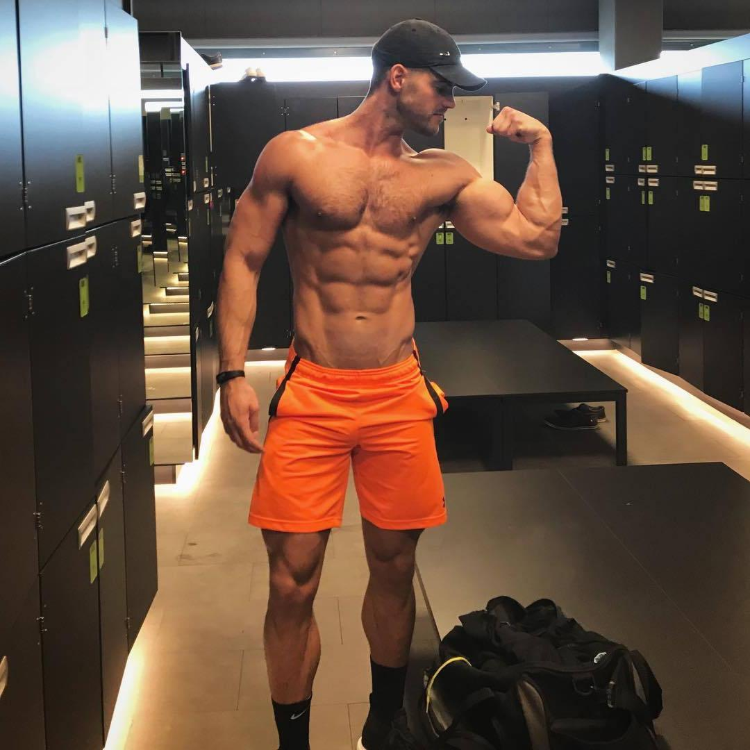 hairy-shirtless-gym-muscle-daddy-flexing-big-biceps-locker-room-abs-hairy-chest-pecs-baseball-cap