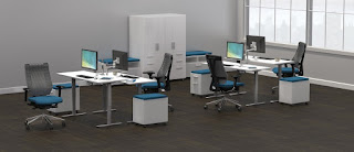 ergonomic office interior with height adjustable tables and responsive chairs
