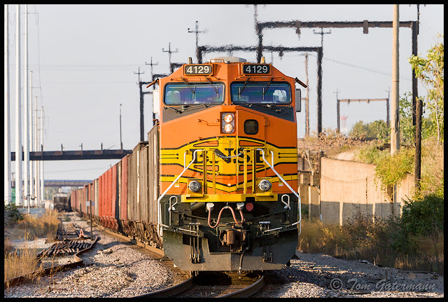 BNSF 4129 is working as the DPU on a train at Branch Street in St. Louis, MO.