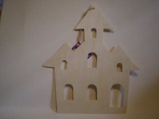 Unpainted wooden haunted house from Dollar Tree