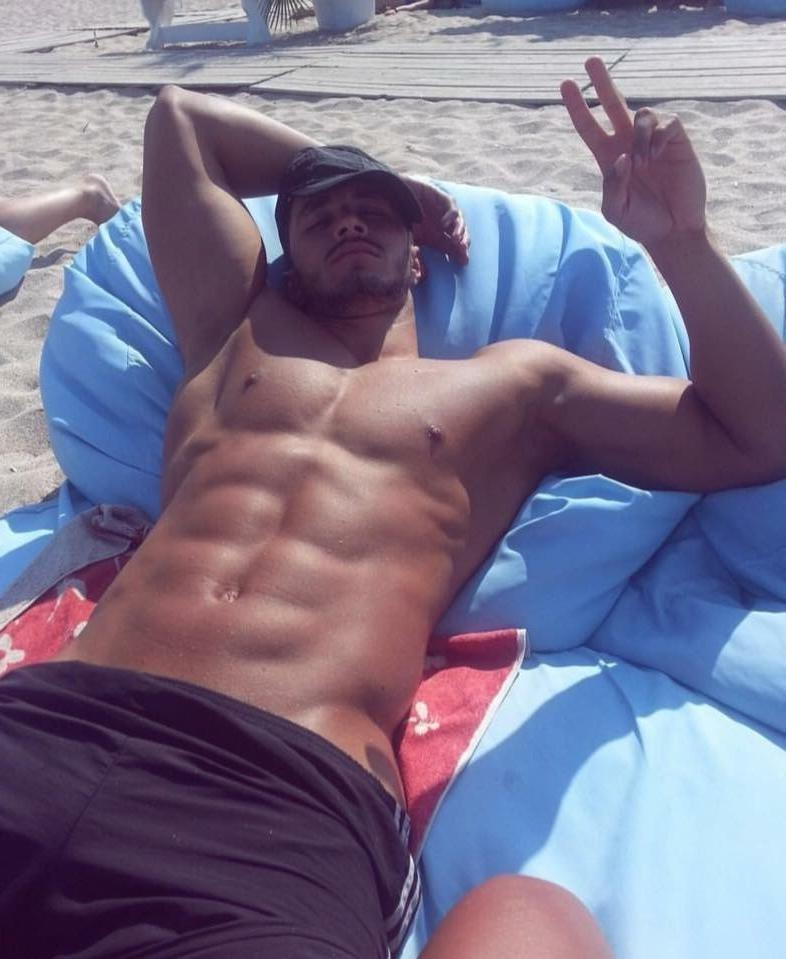 chill-shirtless-american-bro-relaxing-summer-beach-sunny-tanned-fit-body-bad-boy