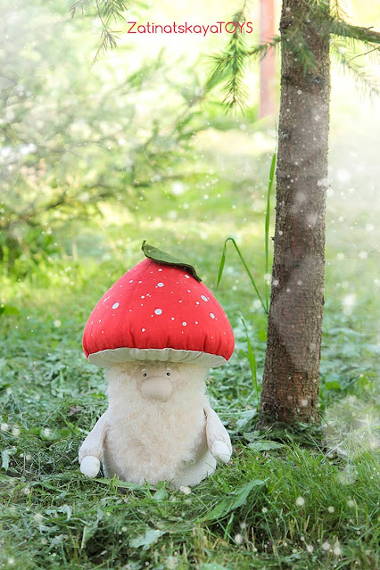 Christmas gnome with a red mushroom hat in the forest by sewing patterns of Zatinatskaya Natalia
