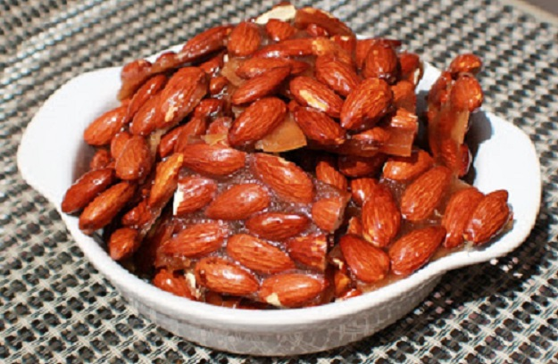 almond rum brittle is like a peanut brittle with rum in it. The sweet hard buttery candy is a delicious almond brittle with a buttery flavor