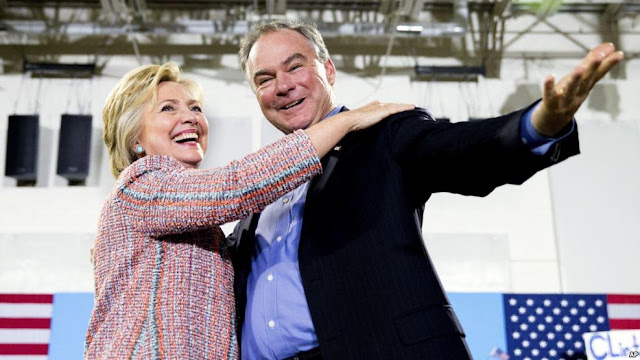 FILE - Democratic presidential candidate Hillary Clinton, accompanied by Sen. Tim Kaine, D-Va., speaks at a rally in Annandale, Va., July 14, 2016. Clinton has chosen Kaine to be her running mate in the 2016 presidential election.