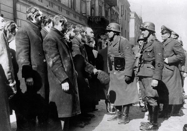 German soldiers question Jews after the Warsaw Ghetto Uprising in 1943. In October 1940, the Germans began to concentrate Poland's population of over 3 million Jews into overcrowded ghettos. In the largest of these, the Warsaw Ghetto, thousands of Jews died due to rampant disease and starvation, even before the Nazis began their massive deportations from the ghetto to the Treblinka extermination camp. The Warsaw Ghetto Uprising -- the first urban mass rebellion against the Nazi occupation of Europe -- took place from April 19 until May 16 1943, and began after German troops and police entered the ghetto to deport its surviving inhabitants. It ended when the poorly-armed and supplied resistance was crushed by German troops.