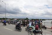 Thanh niên quê Đắk Lắk chạy xe máy lên giữa cầu Phú Long rồi nhảy xuống sông