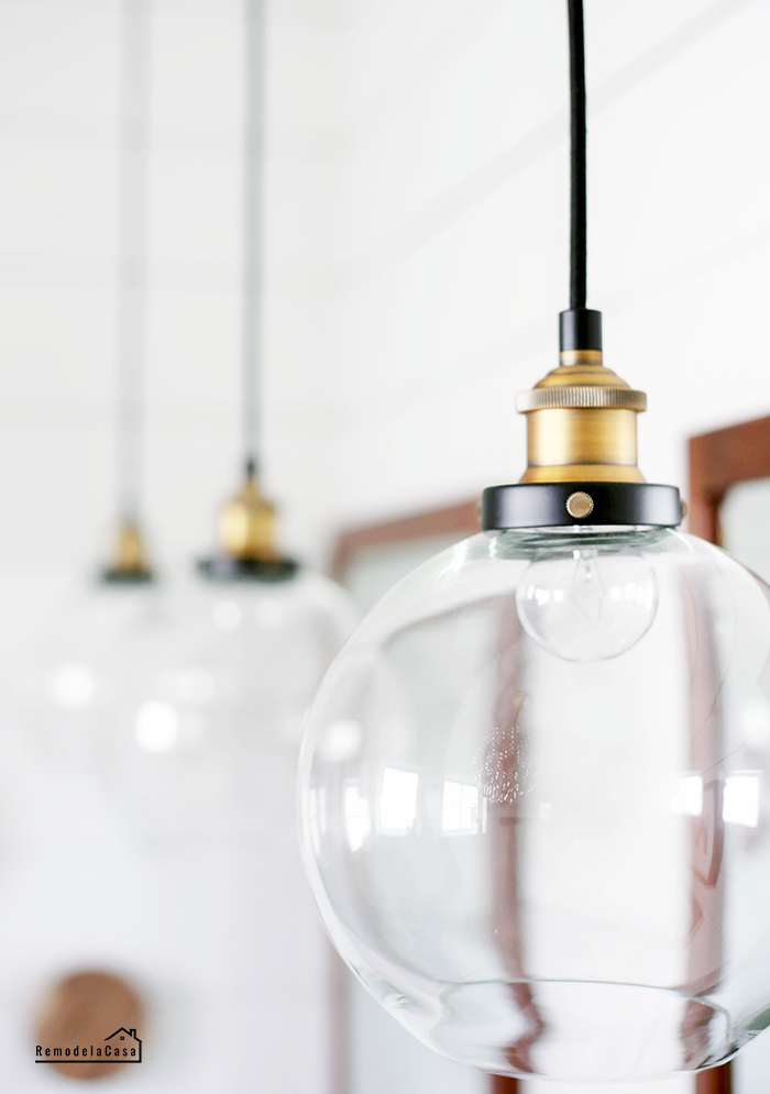 Industrial pendant globes in white bathroom