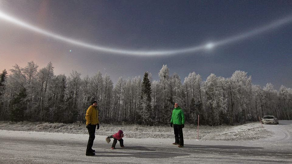 These are sun halos, which are produced by the ice crystals in cirrostratus clouds. - You'll Never Believe What This Family Saw in the Sky Outside Their House in Finland.