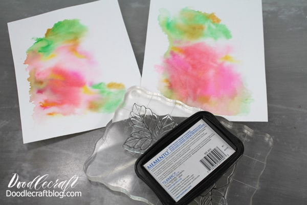 Use Momento ink to stamp an image on a watercolor wash paper.