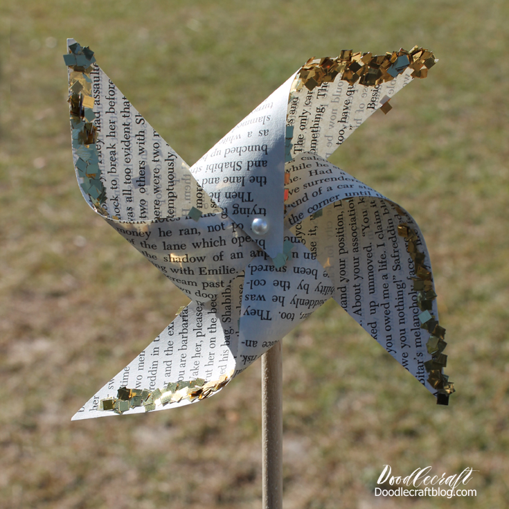 Papercraft with upcycled book pages filled with text, into a spinning pinwheel.