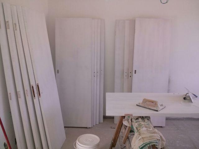 Pintando portas em BH.13