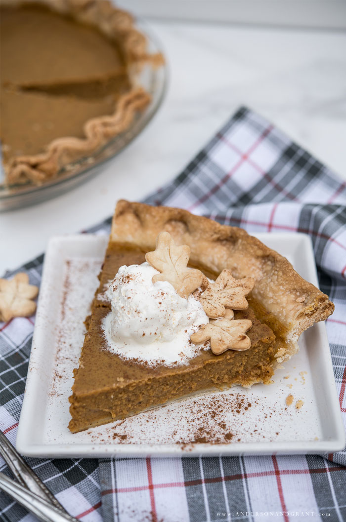 Piece of pumpkin pie with whipped cream