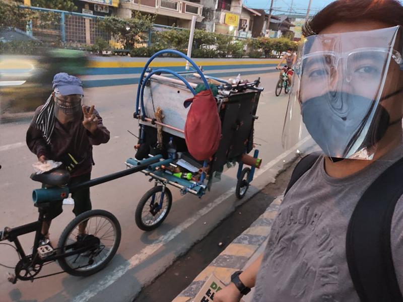 This 59-year-old vlogger bikes around Metro Manila to give toys to street children