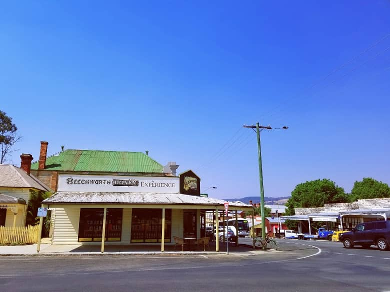 a picture of an outdoor view, in the main street with old buildings