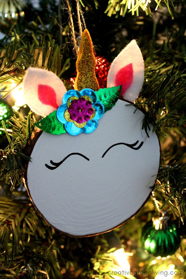 DIY unicorn ornaments made from wood slices, felt scaps and glitter foam