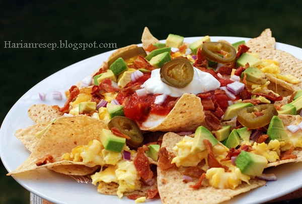 Menurut Wikipedia Nachos atau nacho merupakan salah satu makanan a la Tex Cara Membuat Nachos Tortilla Chips, Camilan Gurih Ala Meksiko