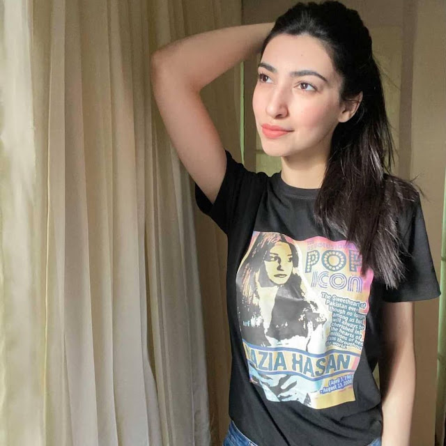 A popular model, Amina Sultan spotted wearing Nazia Hassan t-shirt with a blue jeans.
