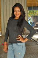 Actress Bhanu Tripathri Pos in Ripped Jeans at Iddari Madhya 18 Movie Pressmeet  0073.JPG